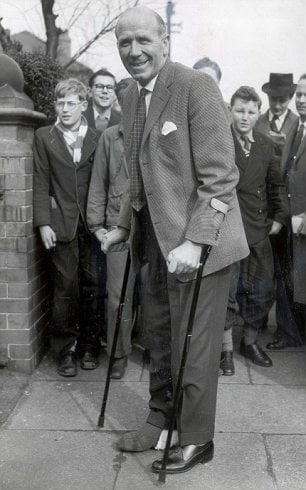 Pkt 1813 - 129874 SIR MATT BUSBY 18TH APRIL 1958 MATT CAN STILL SMILE Though still on crutches and with a foot in plaster, Manchester United manager Matt Busby can still muster a smile as he arrives in Manchester today (Friday) from Munich, where he has been recovering from injuries received in the air disaster which cost the lives of eight members of his team. Matt is hoping he will be able to lead United on to the field for the F.A. Cup Final against Bolton Wanderers at Wembley on May 3.